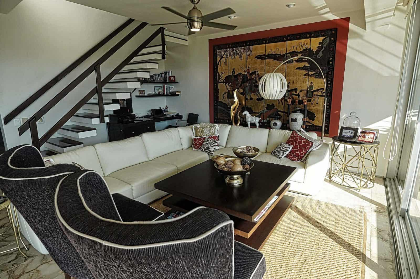 Magia Penthouse living on 2 levels with 2 cozy seating areas on the main level