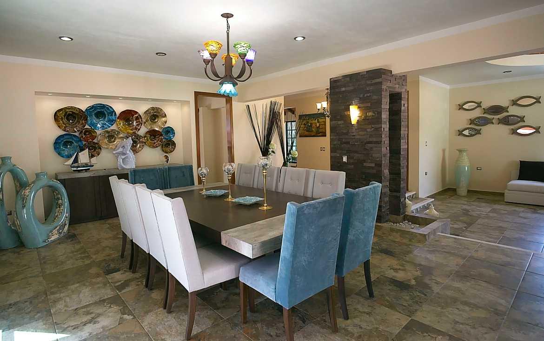 Hacienda Xcaret dining room to living room