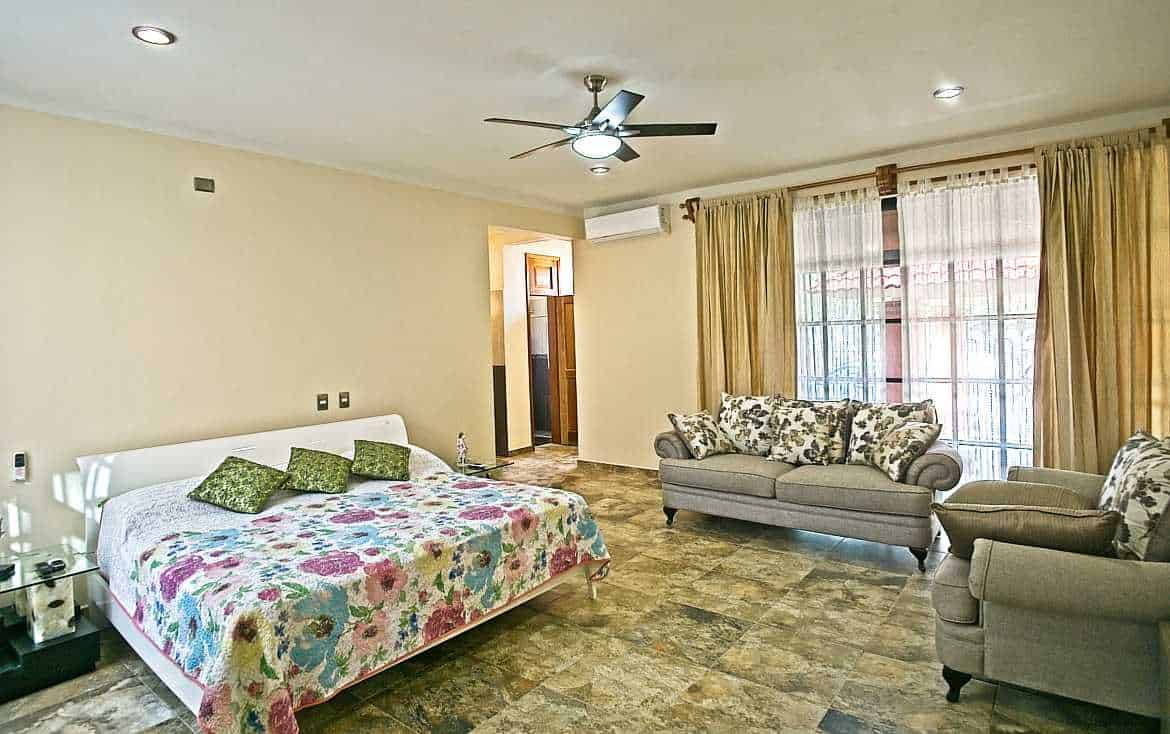 Bedroom #2 is spacious with sofa and ensuite bathroom and jacuzzi