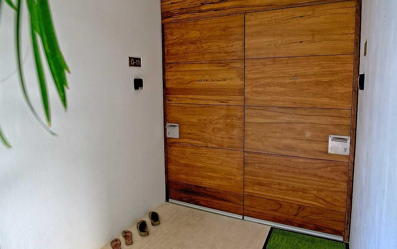 Doors open on a floor pivot.